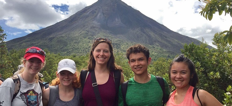 language immersion students in front of the Arenal volcano