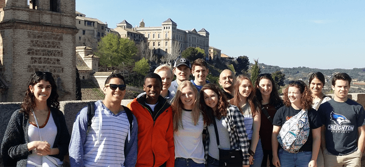 Group of kids in front of a castle