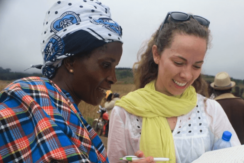 Two women discussing a Community Partner project in Africa